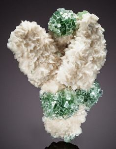 "This mineral beauty, dubbed the ""snow angel,"" was discovered during the digging of a well in India. The specimen is a silicate mineral called apophyllite-(KF), which appears in volcanic rocks."