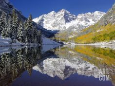 The Maroon Bells Casting Reflections in a Calm Lake in Autumn Photographic Print by Robbie George at Art.com