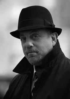 Billy Joel.  Several years ago, the piano man mastered the musical art of creating songs that range from thoughtful ballads to rockin' sing alongs.  My three favs:  Just The Way You Are, You May Be Right & Piano Man