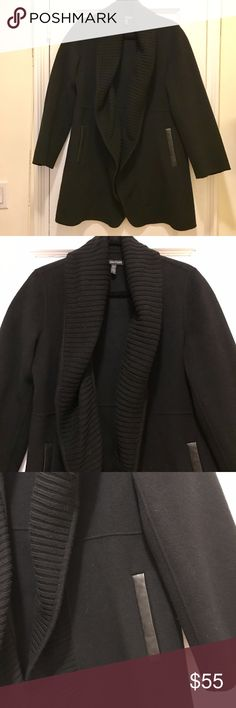 Eileen Fisher cardigan coat Eileen Fisher overcoat. Black wool cardigan style coat. Open, no closure in front. Knit shawl collar. Front pockets with leather strips. Clean, never worn. Size S. Eileen Fisher runs a little bigger and its is cardigan style with no closures, therefore I feel most sizes can easily wear this size S-L. Please let me know if you have any questions! Eileen Fisher Jackets & Coats Pea Coats