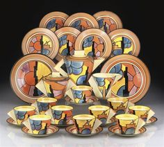 """""""Sunray"""" Art Deco tea set by Clarice Cliff, 1929.  Sold for L11,875 at Christie's, South Kensington, London, 5/1/2008.  At today's currency exchange rate, that equates to approx. $18,442."""