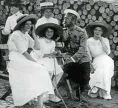 Grand Duchesses Tatiana, Anastasia and Olga with Tsar Nicholas II and Tsarina Alexandra (background)