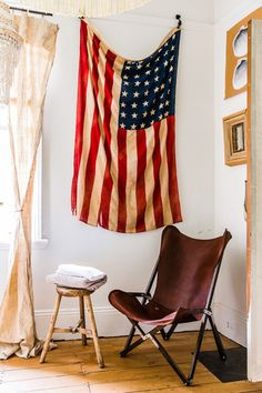 Eclectic Bedroom by Nikki To Photography. Rustic industrial with a USA flag