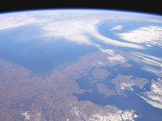 Denmark seen from the Space. The crew of the ISS took this panoramic view that extends from the North Sea coast of the Netherlands on the left to the Baltic Sea shores of Sweden on the right. The late-winter landscape has little snow cover except over northeastern Germany, Sweden, and the rugged mountains of Norway.