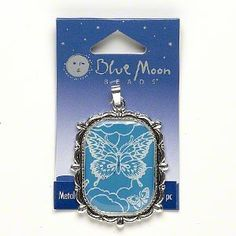Pendant, Blue Moon Beads®, silver-plated pewter/resin/steel, clear/teal green/white, 41x36mm rectangle with butterfly design