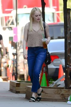 Emma Stone wearing Where Mountains Meet Lolita Knit Tank, Rag & Bone Bradbury Small Flap Hobo Bag in Black, Mansur Gavriel Suede Double Strap Sandals and AG the Phoebe Vintage Jeans in 10 Years Wick