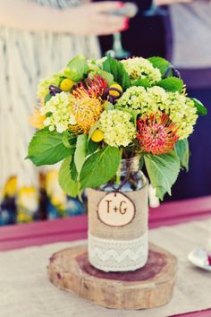 Great mix of flowers in this burlap themes centerpiece