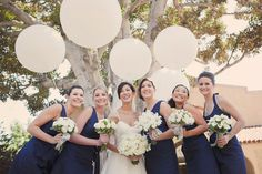 navy blue bridesmaids gowns, great contrast to bride's white gown and bouquets