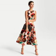"""This spring it's all about match sets and our latest midi skirt is exploding with poppy florals to wear with its matching bodice top…or separate with our Off-the-Shoulder Bandage Sweater. You'll look equally chic either way. Poppy full midi skirt in ecru with nailpolish Sits 3/4"""" below waist; 8"""" below the knee Hidden side zip with hook-and-eye closure Black waistband; side seam pockets Lined Regular: Approx. 32 1/2"""" center back length Petite: Approx. 29 5/8"""" center back length…"""