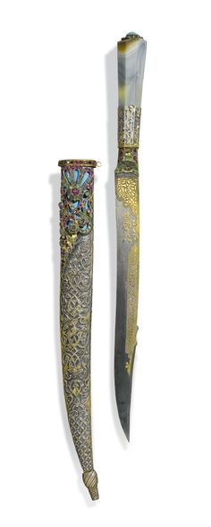 AN OTTOMAN DAGGER WITH BANDED-AGATE HILT AND JEWELLED SILVER SCABBARD, TURKEY, 19TH CENTURY the faceted hilt composed of banded-agate mounted with a turquoise stone, set with colourful gemstones leading to the steel blade with overlaid gold inscription with spurious date 1112 AH/1700 AD, the silver scabbard worked with repousse design and set with pale blue enamel and colourful stones, within fitted case Quantity: 2dagger: 40cm. scabbard: 33cm.  25,115 - 41,858USDLOT SOLD. (94,179