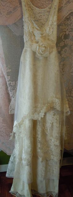 Lace Wedding Dress handmade by vintage opulence on Etsy  The top is a soft ivory lace with lining,embroidered appliques, with a vintage lace sash