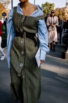 twist on a uniformed look. pinstripe blouse with a button up grey formal dress tied together with a black belt. Worn together all loose