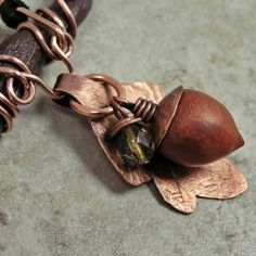 Handmade polymer clay acorn, with tree branch and oak leaf