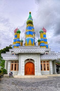 "Nurumi Masjid, Indonesia - some call it ""Candy Masjid,"" because of its colorful domed spires that resemble lollipops. Mosque Architecture, Ancient Greek Architecture, Religious Architecture, Gothic Architecture, Beautiful Mosques, Beautiful Buildings, Important People In History, Temples, Indian Doors"