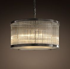 love this chandelier for streamlined, art deco-ish design to go with my milo baughman buffet over dining room table