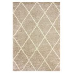 Anchor your living room seating group or define space in the den with this stylish shag rug, featuring a diamond trellis motif for eye-catching appeal.  Product: RugConstruction Material: 100% PolypropyleneColor: BeigeFeatures: Machine made Note: Please be aware that actual colors may vary from those shown on your screen. Accent rugs may also not show the entire pattern that the corresponding area rugs have.Cleaning and Care: Spot treat with a mild detergent and water. Professional cleaning…