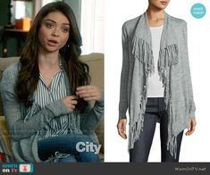 Haley's grey fringed cardigan on Modern Family. Outfit Details: https://wornontv.net/88504/ #ModernFamily
