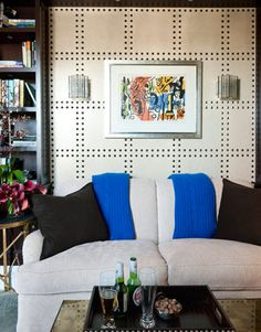 Very interesting wall treatment.  Could even be a DIY headboard application.  Panel could be affixed to the wall, or done on corkboard with thumbtacks or upholstery tacks.