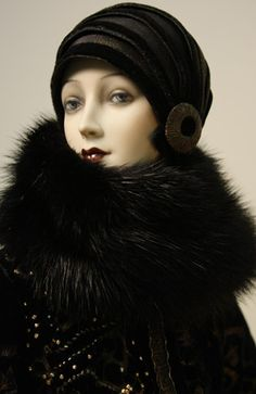 Beautiful handmade porcelain art dolls with stunning, expressive features and splendid hand sewn clothes and accessories show the high workmanship of Moscow-based artist Alexandra Koukinova. A graduate of Chekhov Art Theatre's school-studio and a member of the Russian Union of Artists she started her own namesake company in 1989.