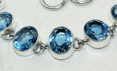 Blue Topaz bracelet designed and created by Sizzling Silver. Please visit  www.sizzlingsilver.com. Product code: BR-9605