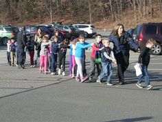 State police personnel lead children from the Sandy Hook Elementary School in Newtown, Conn. on Dec. Knowing someone that is from Newtown, Connecticut that has family that attended Sandy Hook Elementary made it hit even closer to home. Sandy Hook, Newtown Shooting, Innocent Child, Innocent People, School Shootings, Just Girly Things, Scary Things, State Police, Local Police