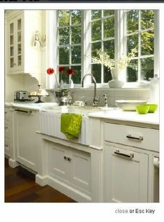 kitchen windows above sink | sconces in kitchen in between windows over sink