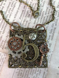 Excited to share the latest addition to my #etsy shop: Journal Number Five  Steampunk Victorian Necklace Mixed Metal  Jewelry Unisex Wearable Art Mixed Media Handmade Necklace #accessories #bronze #mothersday #numberfive #trendypopularetsy #mixedmedianecklace