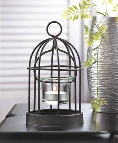 The perfect perch for a candle! This charming iron birdcage candleholder features a glass candle cup, charming wire-frame design, and a hanging loop at top. Place a candle inside and light it to enjoy its cheery charm. Iron Candle Holder, Candle Holders Wedding, Lantern Candle Holders, Candle Stand, Candle Lanterns, Glass Candle, Votive Candles, Candleholders, Mini Iron