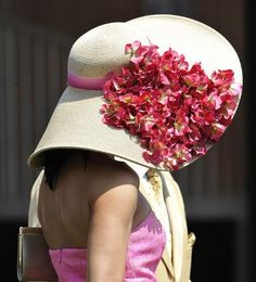 Large brimmed derby hat with a pink band and an array of red flowers
