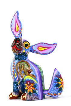 I love the beautifully detailed Oaxacan wood carvings...miss shopping for them at the Farmer's Market in Monterey!