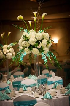 Wedding flowers that look like fireworks. White and aqua flowers.