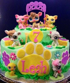 Leah's Littlest Pet Shop Cake. It was delicious!  I love how it came out.  Only the paws and flowers were fondant-the cake was icing:)