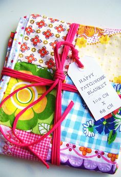 A happy patchwork baby blanket by SillyOldSuitcase on Etsy