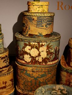 """A collection of American """"Wallpaper Hat Boxes""""."""
