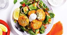 Reduce the heat of these fiery fish cakes with a dollop of herbed yoghurt and a squeeze of fresh lemon.