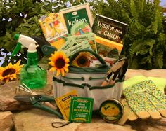 "Gardners gift basket- Love the use of the tool bag for the ""basket"" or you could use an open top watering can. Fill with gardening items"