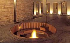 Sunken fire pit and bench; Roth Sheppard