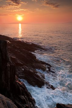 Sunrise at Bailey Island, Harpswell, Maine, with the swirling waves riding up on the rocky shore at the Giant's Stairs