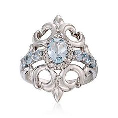 aquamarine birthstone ring with baroque character and diamond accents ensconced in elaborate scrolls