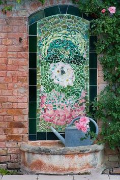 1000 images about wall fountains on pinterest wall for Garden wall mosaic designs