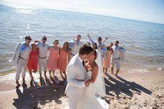Beach wedding, wedding photography, Northern Michigan wedding, wedding party photo, mismatched bridesmaid dresses, tan and blue groomsmen suits