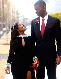 How cute is this couple?! She's wearing Mac Duggal Style 61728R. Black prom dress with long sleeves and keyhole opening. Silver embellishments along the neckline and sleeves.