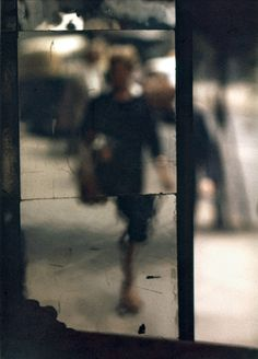 31). As she relaxed over a pastis, she caught sight of a reflection in a mirror by the bistro's door...