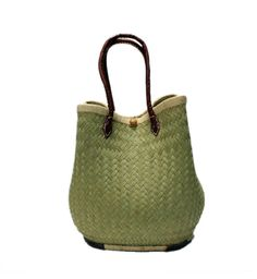 Mia  our Straw tote, basket, bag natural color is always beautiful.  It can be changed it shape to in oval shape. This pretty basket with a leather handles is made of straw by the artisan women from Madagascar, Africa.  Dimensions: 18W x 14H x 10D