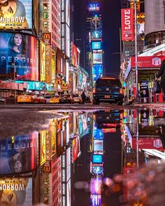 """2,585 Likes, 42 Comments - Elena (@pictures_of_newyork) on Instagram: """"What a wet day today, but look at this beautiful and colorful reflection at Times Square! Great and…"""""""