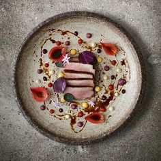 Duck, onion petals, lemon, red cabbage, mayo, chili jam, wild raspberry jam & duck sauce. Dish uploaded by @alvinssto #gastroart