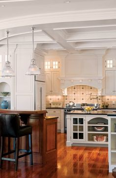 Beautiful white & wood kitchen. Coiffured ceiling, wood floors, leather seating.  Love ! Boston Design Guide