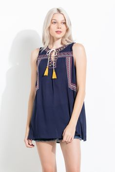 The embroidery on this THML top adds the perfect boho detail perfect for everyday!