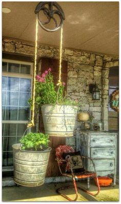 2 buckets and  vintage pulley for flowers on the porch