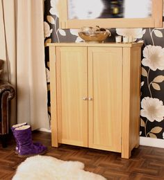 A shoe storage cabinet may serve as a support for a hallway mirror. Description from furnitureinfashion.net. I searched for this on bing.com/images